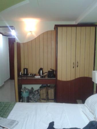 Ponmari Residencyy: Towards door from bed