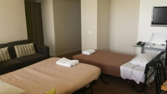 Rydges North Sydney: Queen suite. Living area with sofa beds and roll away