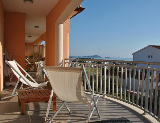 """Villa Lena : The super-long balcony of """"Arta"""", viewed from the couch."""