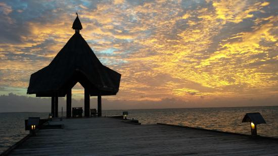 Canareef Resort Maldives: Beautiful sunset as seen from close to our apartment.
