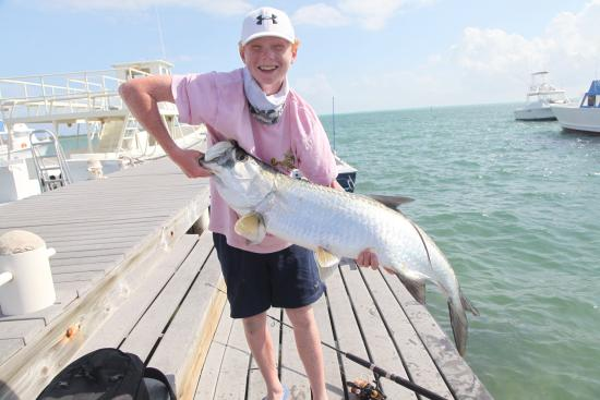 Mutton snapper with jacob on ifish picture of slackem for Grand cayman fishing