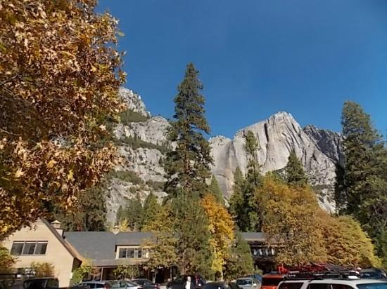 Parking lot with yosemite falls in background picture of for Yosemite valley cabins