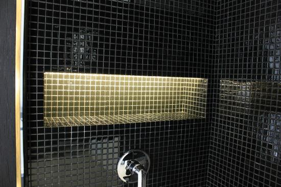 The Click Clack Hotel Shower Is Rather Dark But Has Accent Led Lighting