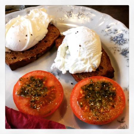The Bastion Kitchen: Two perfectly poached eggs on homemade spelt bread with grilled tomatoes topped with pesto.