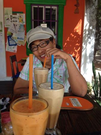 Thongs cafe : My friend w/ all of our smoothies - Tropical Blend is the Orange one