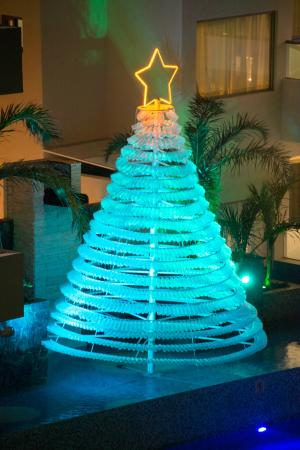 Recycle Christmas Lights.Christmas Tree Out Of Recycled Water Bottles At Night