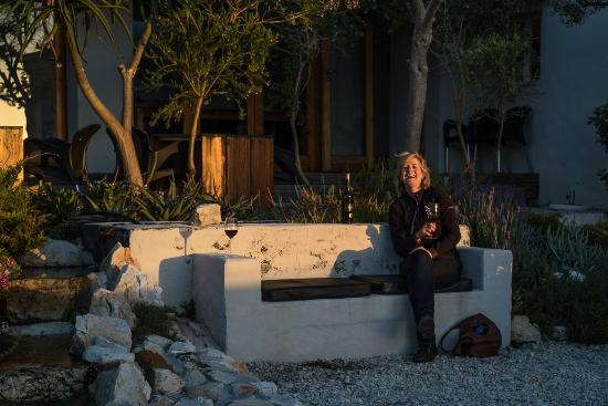 Farm 215 Nature Retreat & Fynbos Reserve: having a glass of wine outside the restaurant