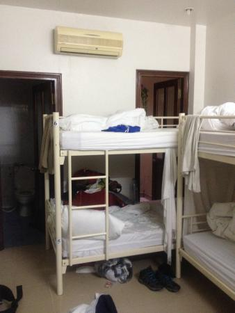 Hoa Binh Hotel: Part of the room, bathroom on left, 'window' Is the door behind beds.