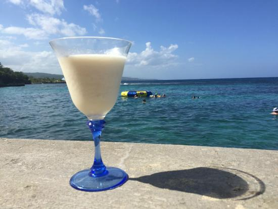 Golden Clouds Villa Estate: David's banana pineapple blended drinks by the water