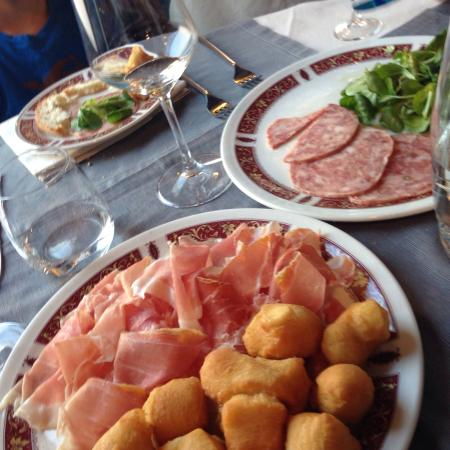 Trattoria Milanese: Fried gnocchi with prosciutto and cooked salami.