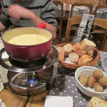 Cafe du Midi : Two servings of moitie-moitie fondue in one pot.