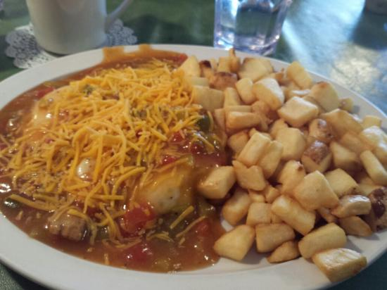 W Cafe: Huevos with eggs over easy and pork green chile and a side of home fries. Delicious!