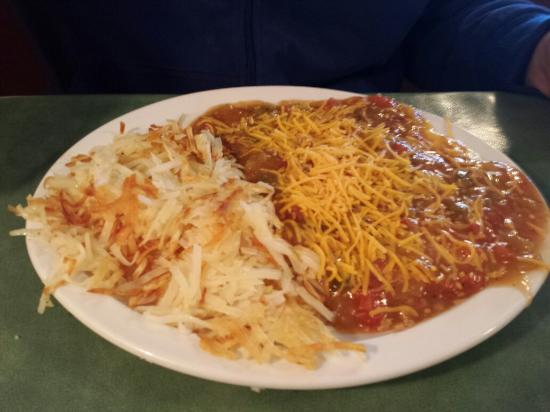 W Cafe: Huevos with eggs over easy with pork green chile and a side of hashbrowns. So good!