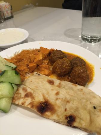 Shalimar Indian Restaurant: Chicken tikka masala, meatball curry and naan.  Also with raitha (yogurt). Delicious.