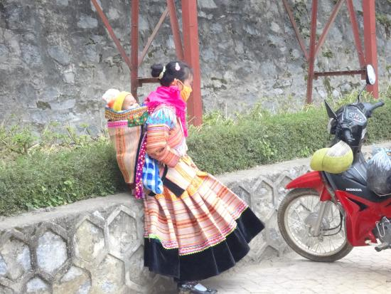 Indochina Pioneer: Hmong girl with baby