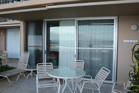 Nohonani Condos : Lanai from outside (orange fencing reflecting off the glass door)