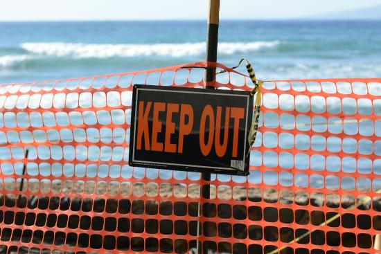 Nohonani Condos : Keep Out sign attached to orange fencing in front of the lanai