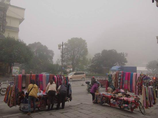 New Li River Hotel (Pantao Road): View outside the hotel. Vendors on the street and a cold misty morning.