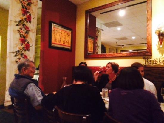 Cuatro Restaurant: Cuatro's simple interior was filled with families celebrating the New Year