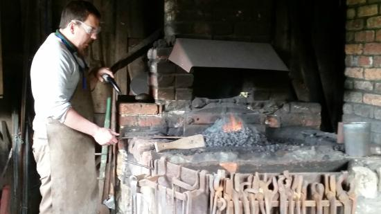 Weald & Downland Living Museum: The apprentice working on an iron piece.