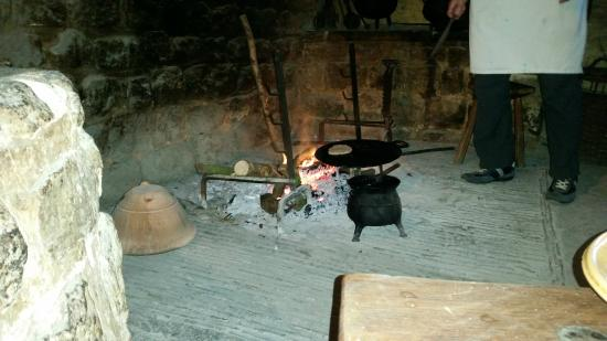 Weald & Downland Living Museum: An old lady was cooking some bread on the fire and making jam. Lovely flavour!