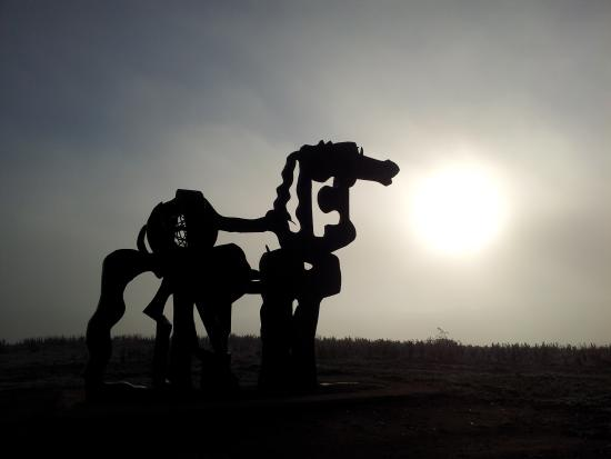 Iron Horse: Sunrise behind the fog