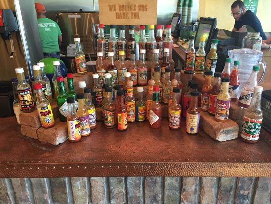 Lime Fresh Mexican Grill: Hot sauce galore. Lots of choices