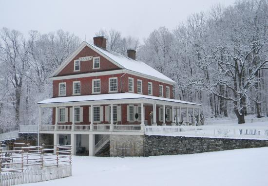 Rock Ford Plantation: The Rock Ford mansion blanketed in snow during Yuletide tours.