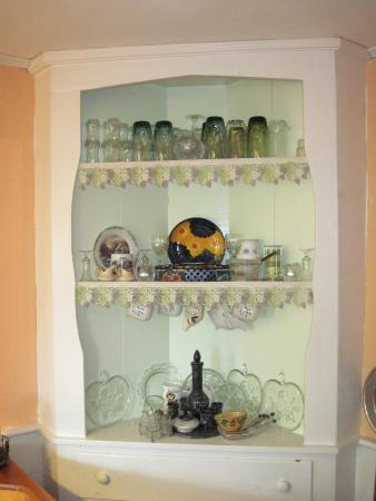 Rowe, MA: China cabinet in dining room with french lace