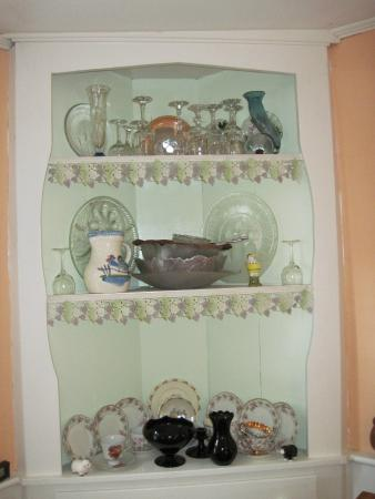 Rowe, MA: French lace decorates the front of the china cabinets