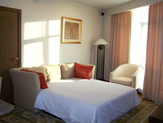 President Park Bangkok : Living room with open extra bed (extendable sofa)