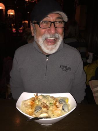 Jake's Restaurant: My dad and his seafood pasta.  He looks so excited!