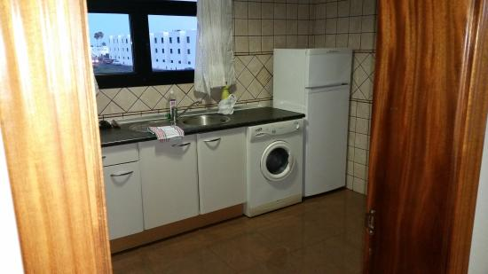 Riviera Park Apartments: Our kitchen,was really clean but we had to get new curtains as there were massive holes ,however