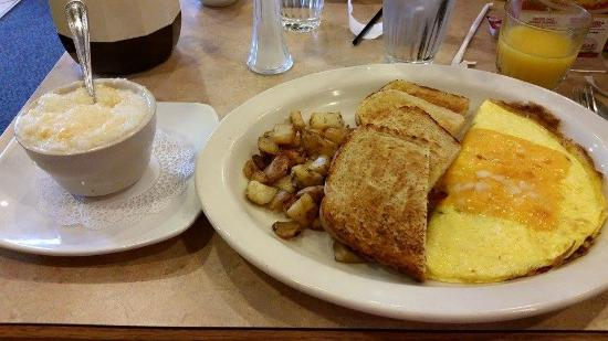 The Egg & I : 3 egg make own omelet,grits,ranch potatoes and sourdough toast
