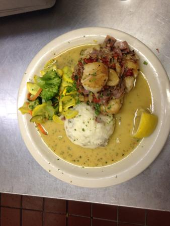 Owl Cafe: Cajun Grilled Ribeye Special topped with a Crab Cake