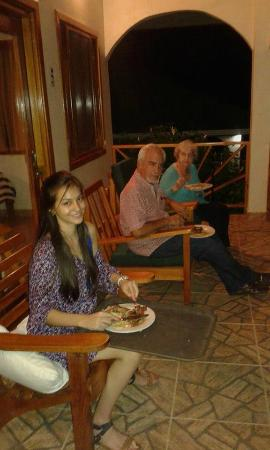 Hooked On Panama Fishing Lodge : My niece, brother and mom outside the cabaña eating on New Year's Eve