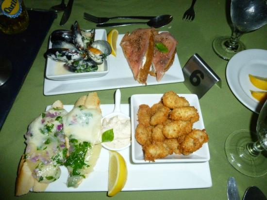 Rock Lobster : Tapas from top eft mussels, top right salmon on bread, bottom left manchego - toasted montage wi