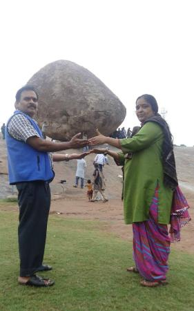 Krishna's Butter Ball: photo taken infront of balancing rock krishna and bharathi is standing