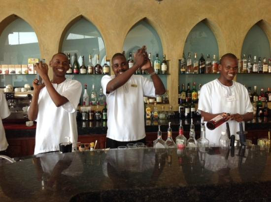 Tamarind Mombasa: Three of the barmen having fun making cocktails.