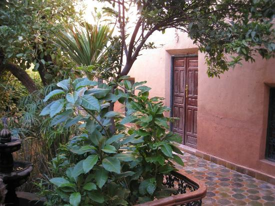 Riad Timadrouine: patio and door to suite on ground floor