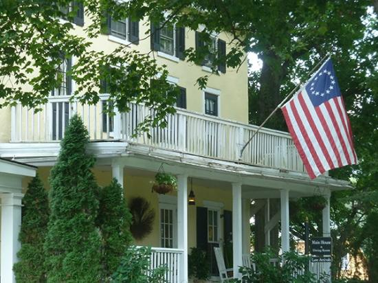 Fairville Inn Bed and Breakfast: A period flag waves from the Inn's front porch.