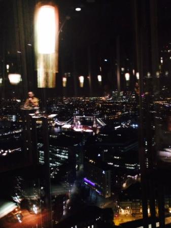 view of tower bridge from aqua shard table aqua shard subdued lighting