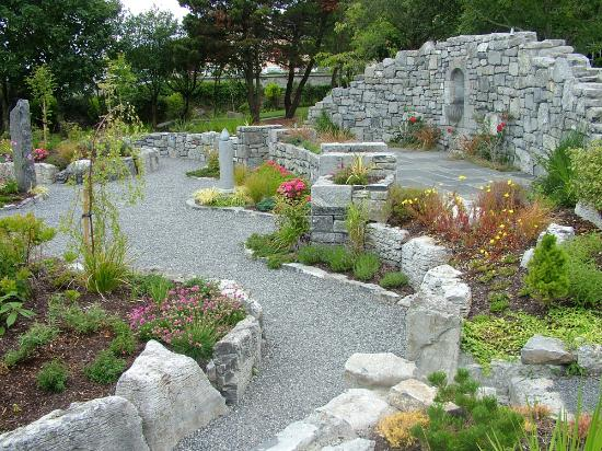 Hand carved standing stones surrounding the garden 39 s for Garden design galway