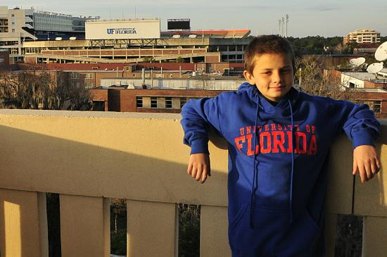 "Reitz Union Hotel - UF Campus: My son with ""the Swamp"" in background"