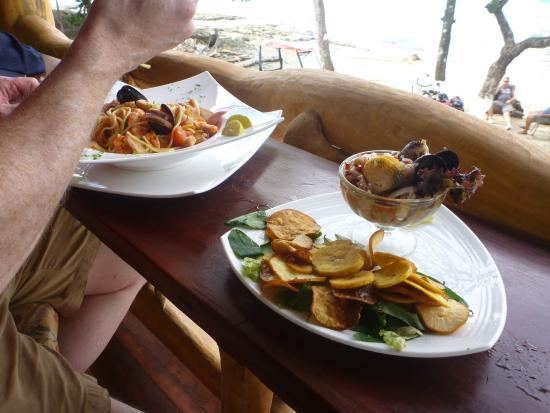 Monli Bar Restaurante and Grill: Ceviche with plantain chips overlooking the beach and great people watching.
