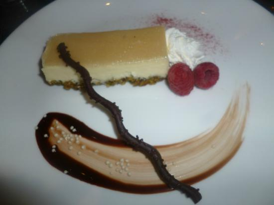 Via Luna: Pistachio Amaretto Cheesecake elegantly presented