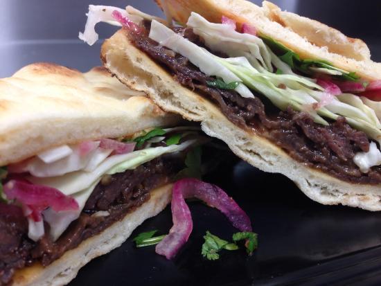 Biankini's : Thai Beef Sandwich served on Naan Bread