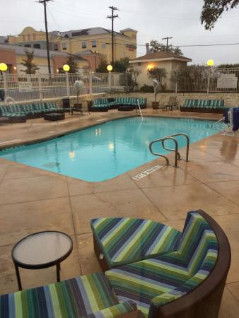 Fairfield Inn & Suites San Antonio SeaWorld/Westover Hills: Outdoor pool and neighboring Courtyard Inn