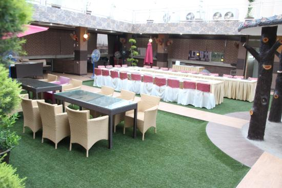 Roof top restaurant picture of palm tree hotel amp restaurant aligarh