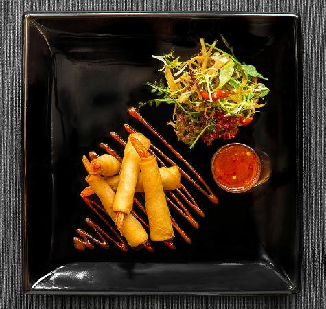 Prawns wrapped in Filo pastry. With a sweet chilli sauce & Oriental salad.